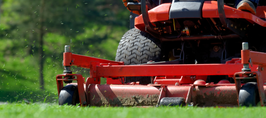 Closeup of red riding lawn mower