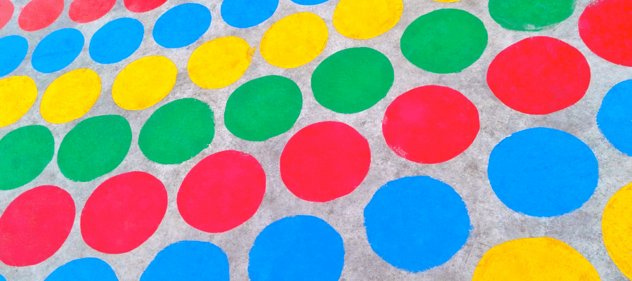 Several red, blue, green , and yellow twister circles.