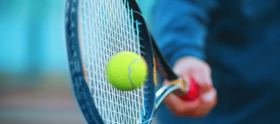 Tennis racket hitting ball
