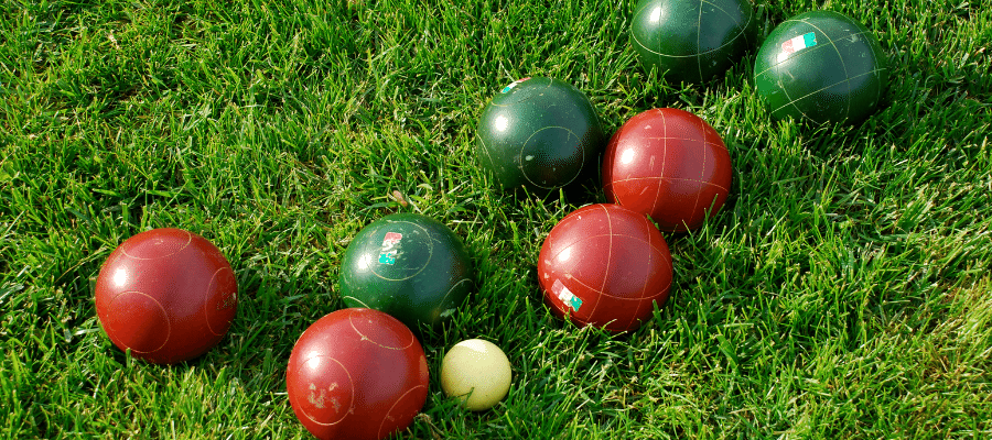 Red and Green Bocce balls on green grass