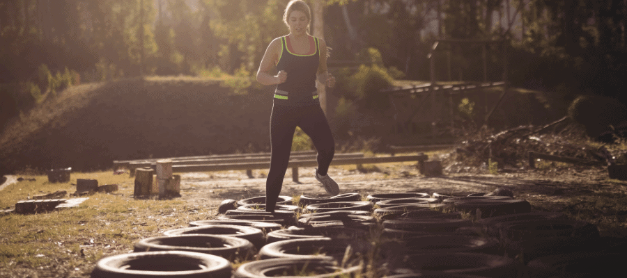 Woman doing tire obstacle course